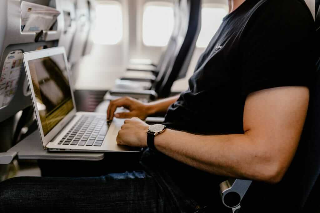 professional blog writer sitting on a plane