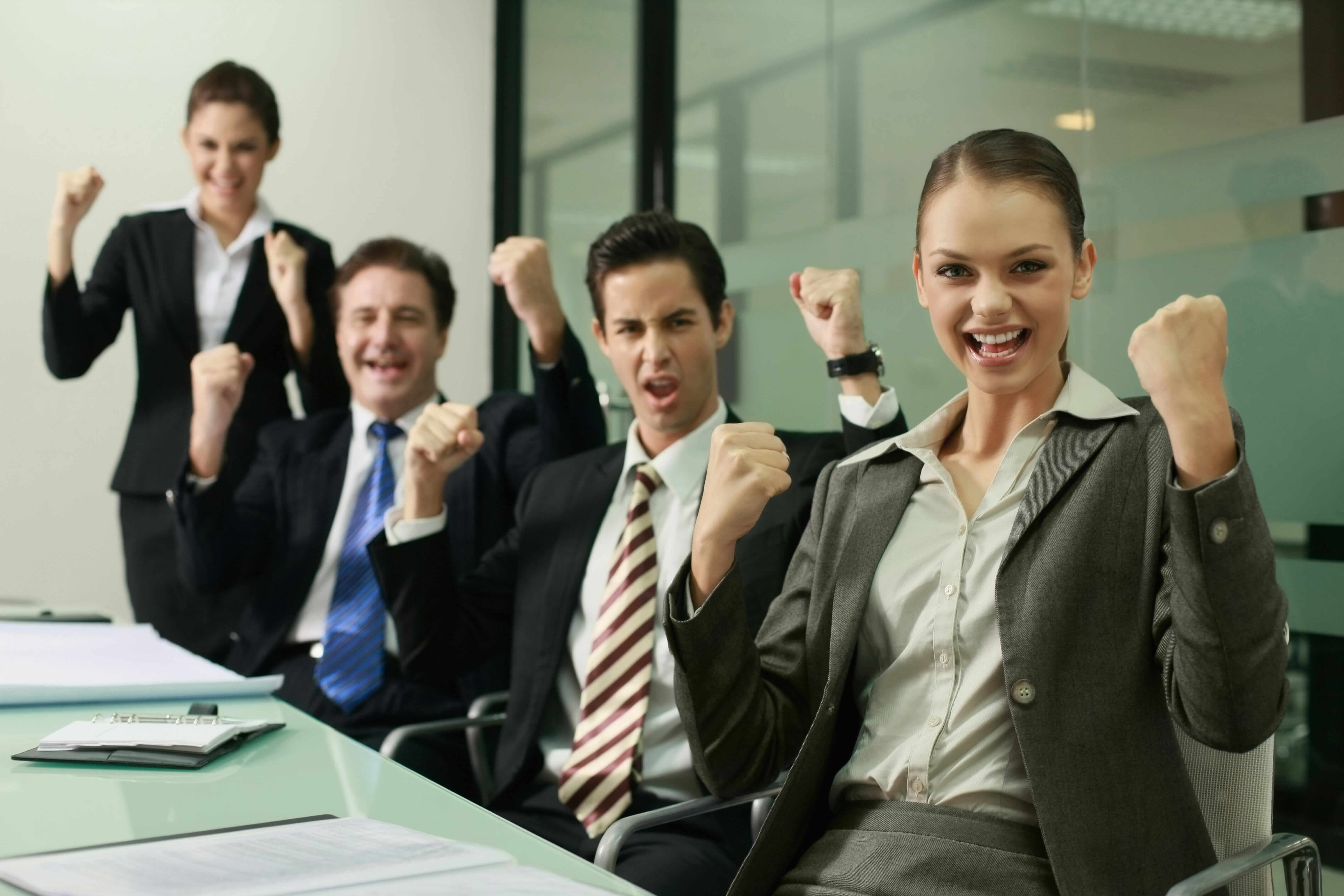 excited coworkers at a meeting