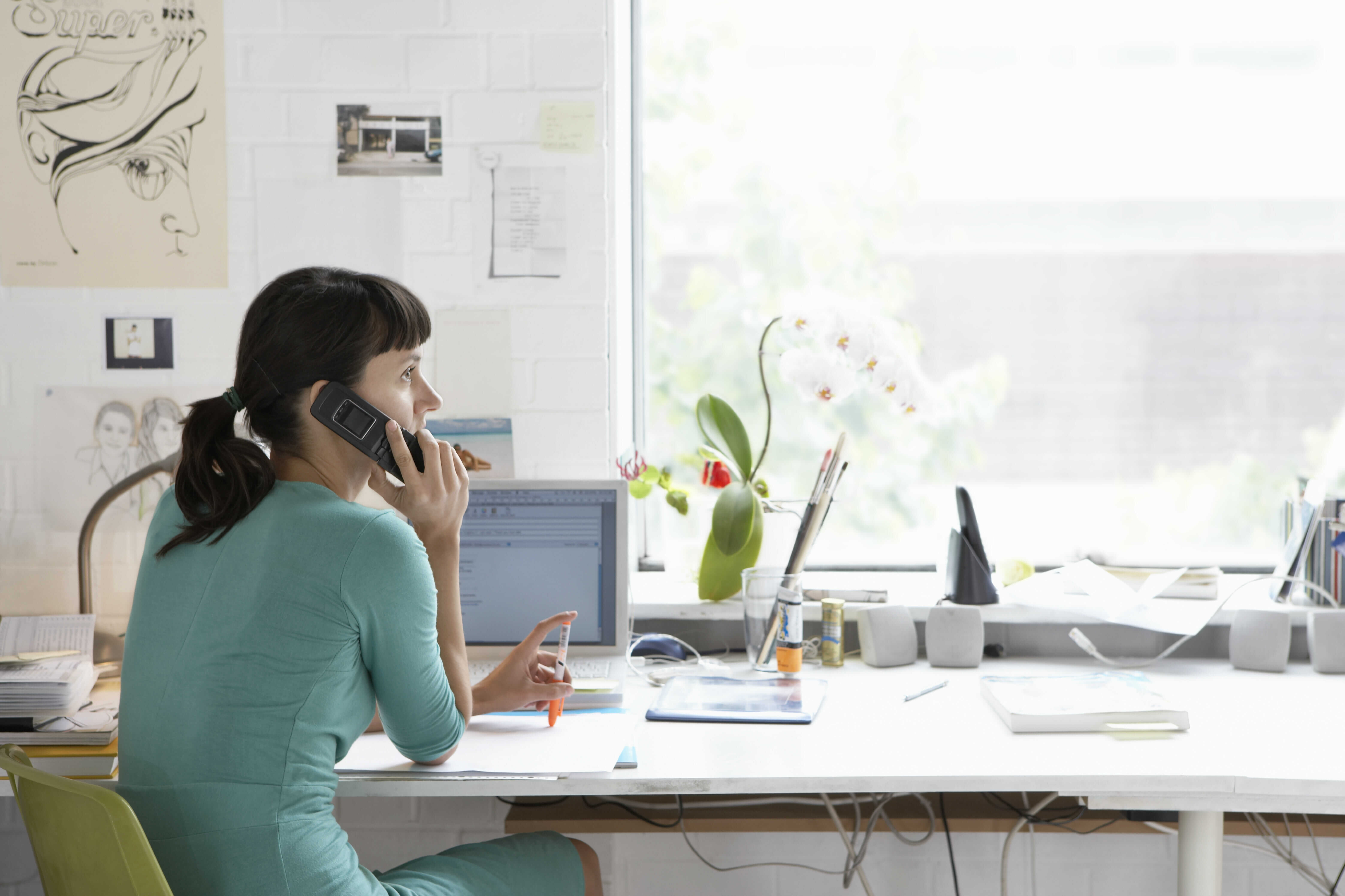 woman sitting at the desk talking about mistakes small businesses make